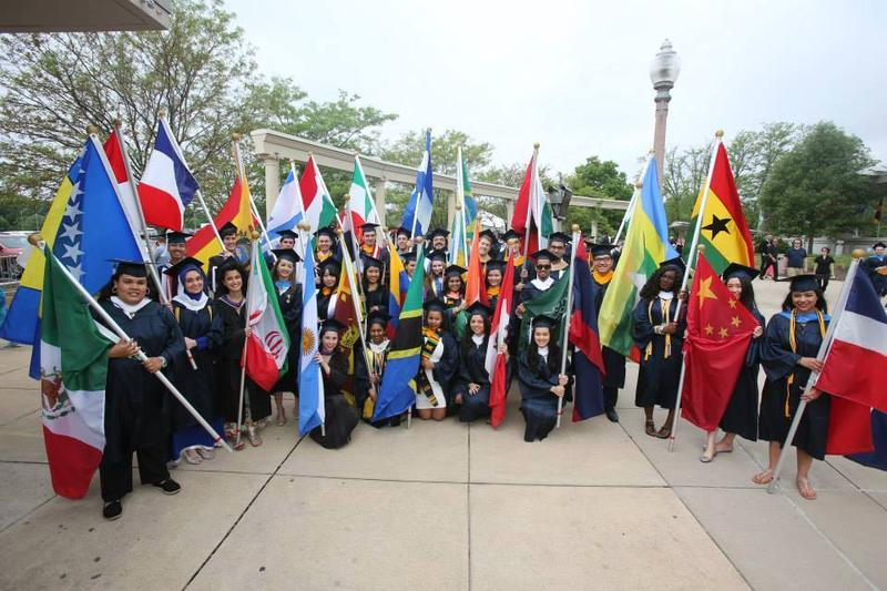 students celebrate graduation day with flags