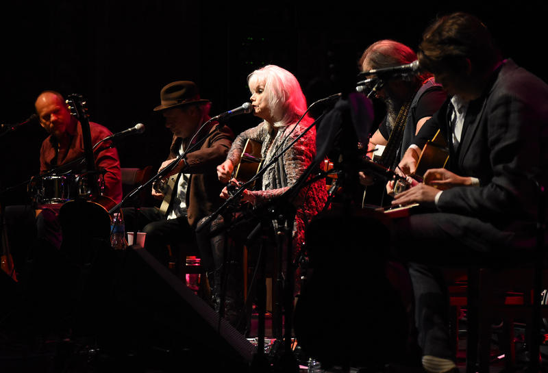 From left, David Pulkingham, Buddy Miller, Emmylou Harris, Steve Earle, and The Milk Carton Kids (Joey Ryan and Kenneth Pattengale) perform during the Lampedusa: Concerts for Refugees at the Rococo Theater in Lincoln, Neb., Oct. 9, 2016.