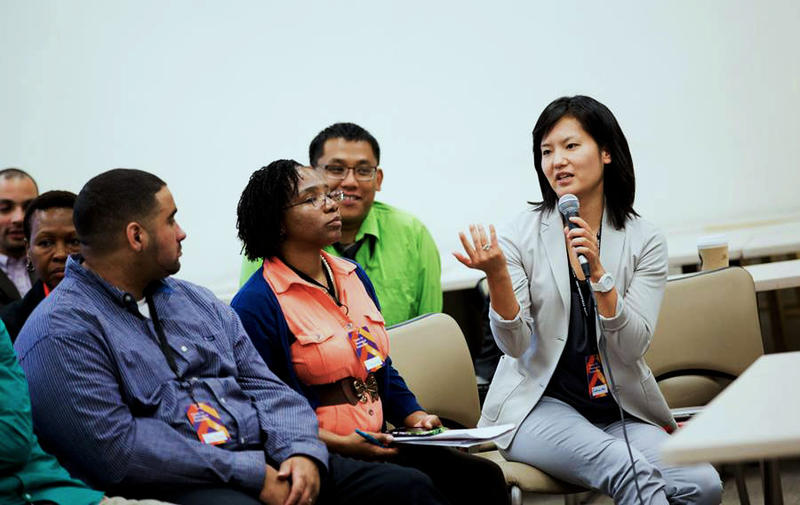 Vince Bantu (left) listens to speaker SueJeanne Koh at the Summit for Future Theological Educators of Color, a conference held in Evanston, Ilinois, in the summer of 2014.