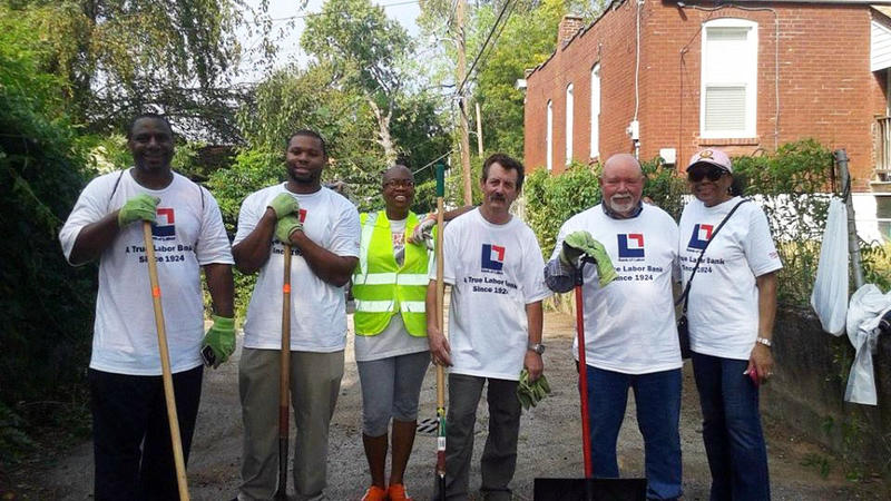 Volunteers at a previous cleanup event organized by Dutchtown South Community Corporation with the International Brotherhood of Electrical Workers