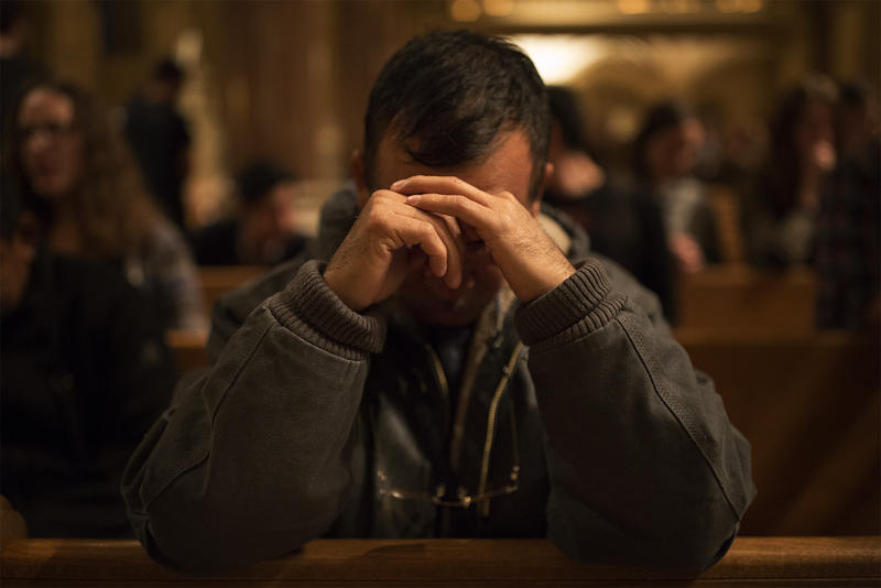 Mario González Contreras, on a speaking tour to spread awareness about the Ayotzinapa 43, attends a Saint Louis University student mass at St. Francis Xavier College Church after speaking with students.