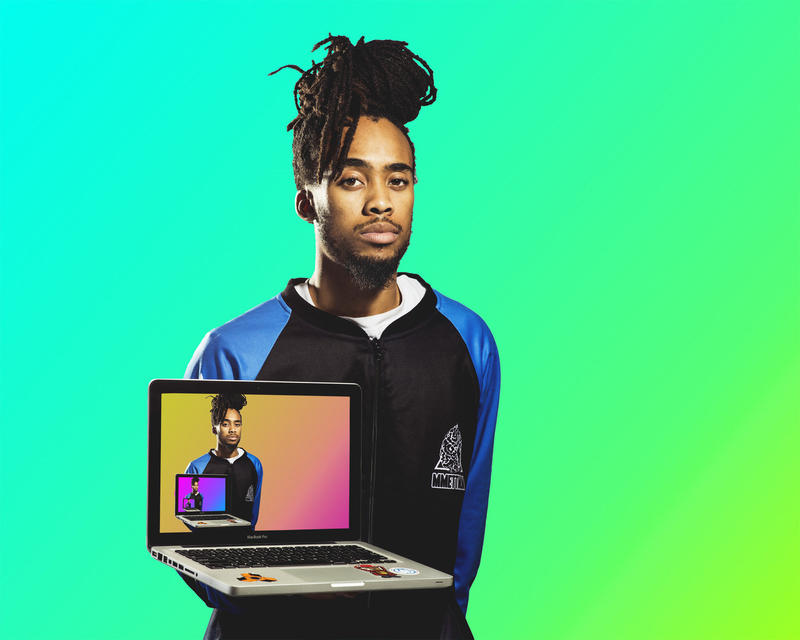 St. Louis rapper and producer Muhammad Austing poses with a picture of himself on his laptop.