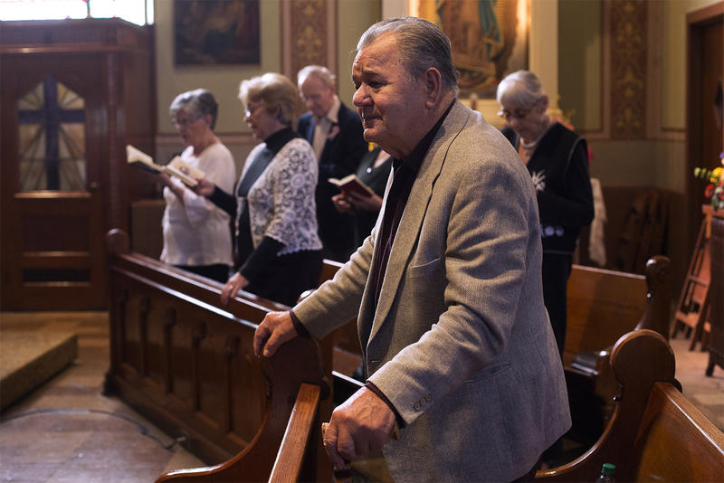 Imre Jokuti, who escaped from Hungary while fighting in the revolution, sings the Hungarian national anthem at St. Mary of Victories Church on Nov. 4, 2016.