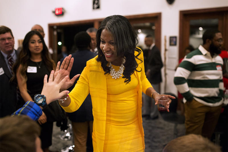 Tishaura Jones high-fives guests at a campaign kickoff party for her mayoral run at Exodus Gallery on Delmar Blvd. on Nov. 15, 2016.