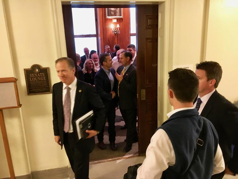 Gov.-elect Eric Greitens shakes hands with Senate Majority Leader Mike Kehoe, R-Jefferson City, last week.