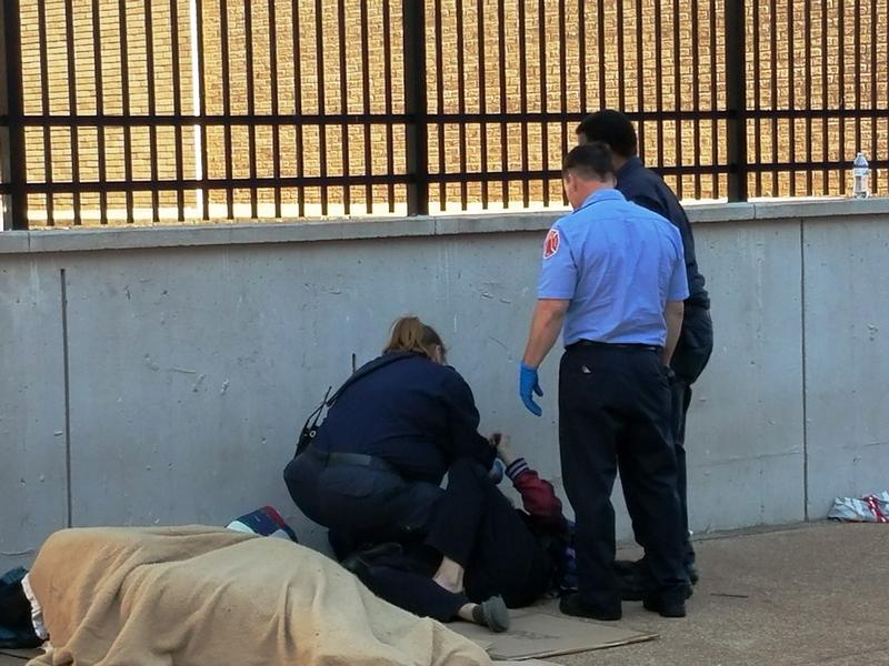 Paramedics with the St. Louis Fire Department tend to a person who had taken the synthetic marijuana known as K2 outside the New Life Evangelistic Center on Nov. 10, 2016.