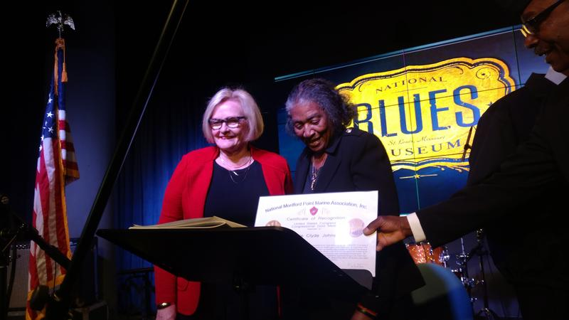 U.S. Sen. Claire McCaskill, left, presents Congressional Gold Medal to the widow of blues legend Johnnie Johnson, to mark his service in World War II.