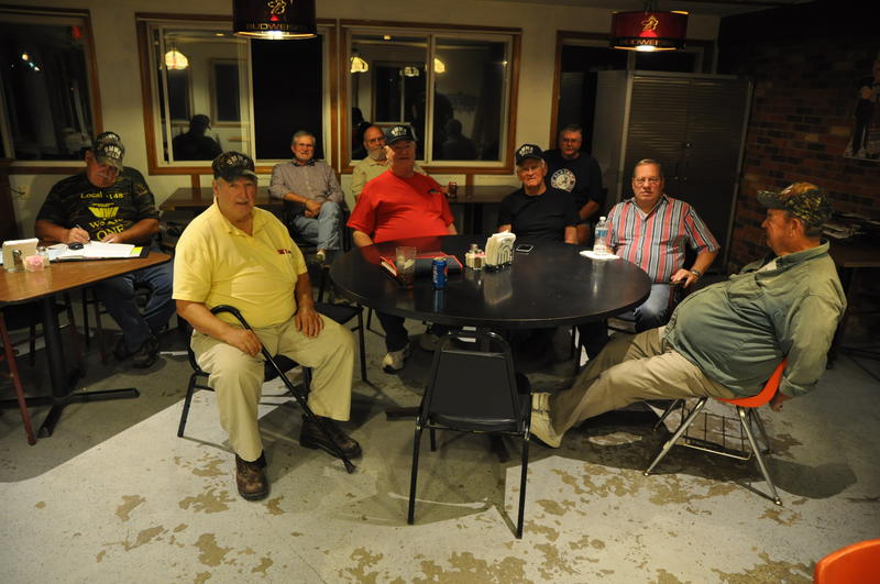 "Members of Local 1148 meet in Marissa, Illinois. Union president Randy Phelps sits in yellow, in yellow, said that without health insurance, he would ""probably make it three months."""