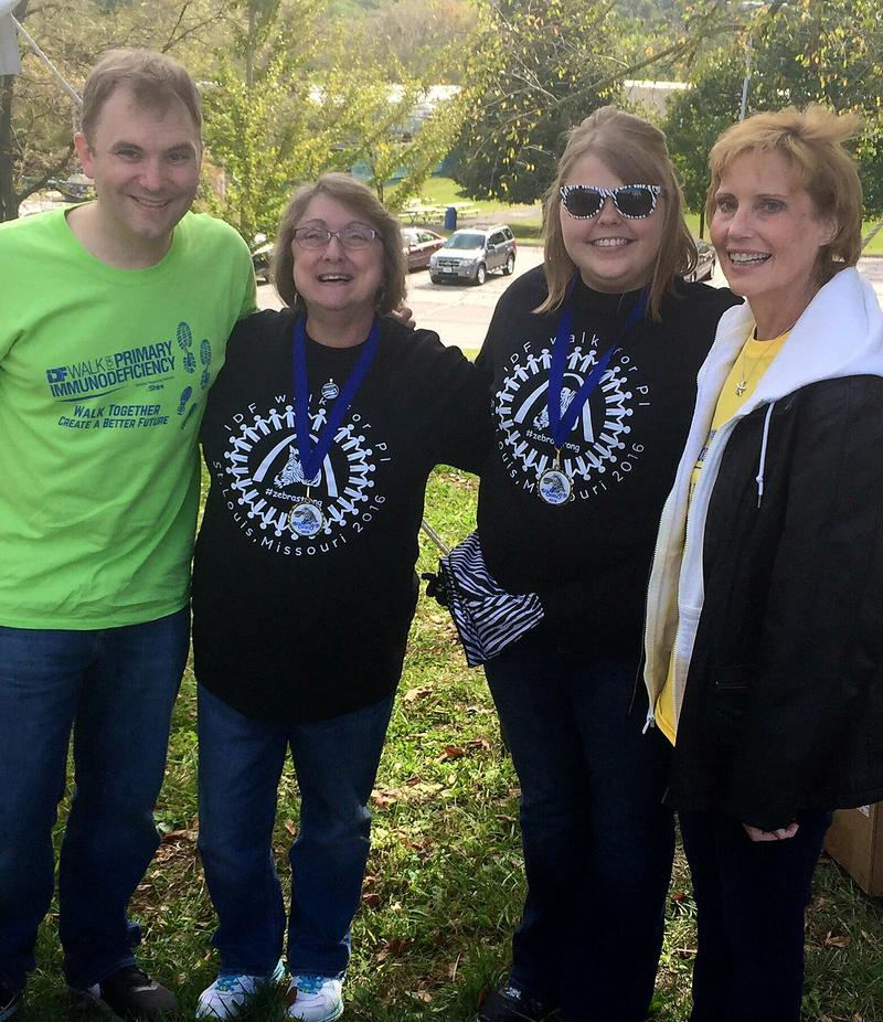 Karen Wheat, second from left, stands with fellow volunteers at the Immune Deficiency Foundation's Walk for PI (Primary Immunodeficiency Diseases) on 10/09/16.