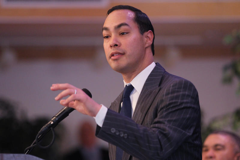 Department of Housing and Urban Development Secretary Julian Castro speaking at lectern at St. Stansilaus Kostka Church in north St. Louis.