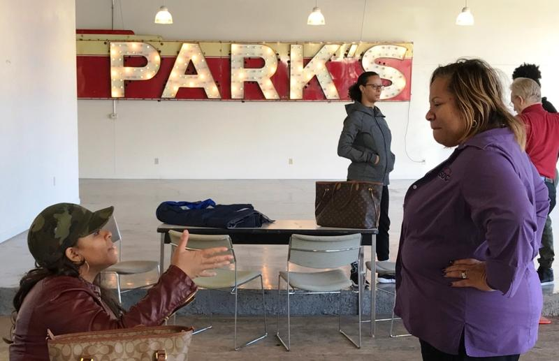 "Applicant Yashica McKinney talks with Lynette Watson with the St. Louis Small Business Development Center on Jan. 4, 2017, at the restaurant contest event. The ""Parks"" sign is from a former business in the building, according to a competition co-sponsor."