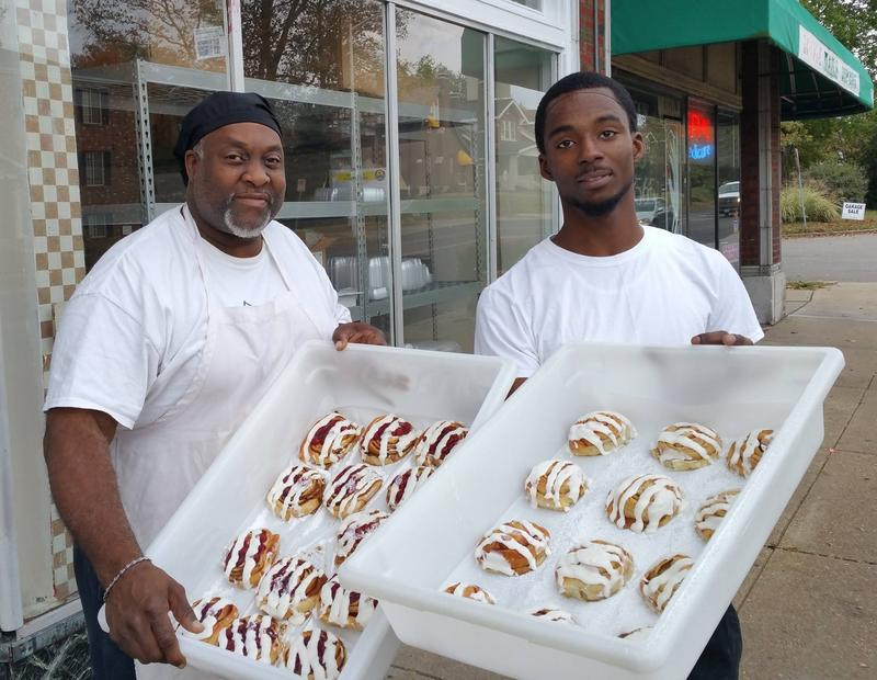 Two bakers pause for a photo with some of Bridge Bread's signature cinnamon rolls on October 25, 2016.