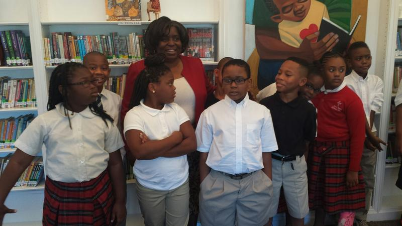 Principal Yvonne Boyd stands with students of River Roads Lutheran School during the opening of a new library in 2015.