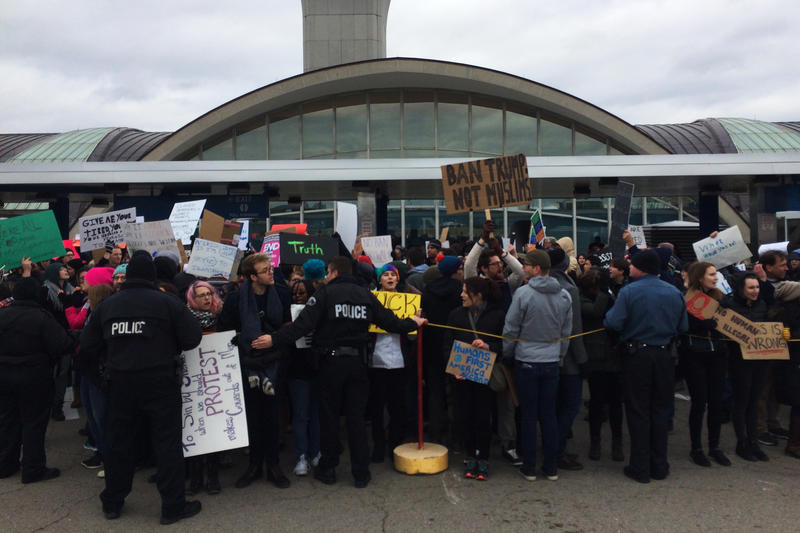 Protesters gathered outside the Terminal 1 departure area at Lambert-St. Louis International Airport on Jan. 29, 2017.