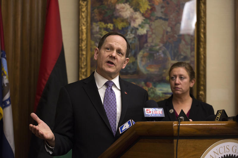 Mayor Francis Slay and Alderman Christine Ingrassia speak to reporters about two measures likely to appear on the April ballot.