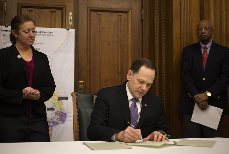 Mayor Francis Slay signs legislation that will ask voters to approve a sales tax increase to fund a Major League Soccer stadium and a north-south MetroLink line. (Feb. 3, 2017)