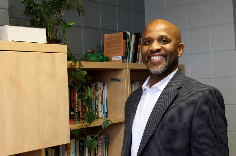 Jerome Morris is the Endowed E. Desmond Lee Professor of Urban Education at the University of Missouri-St. Louis. He's standing next to his bookshelf in his office on Feb. 6, 2017.