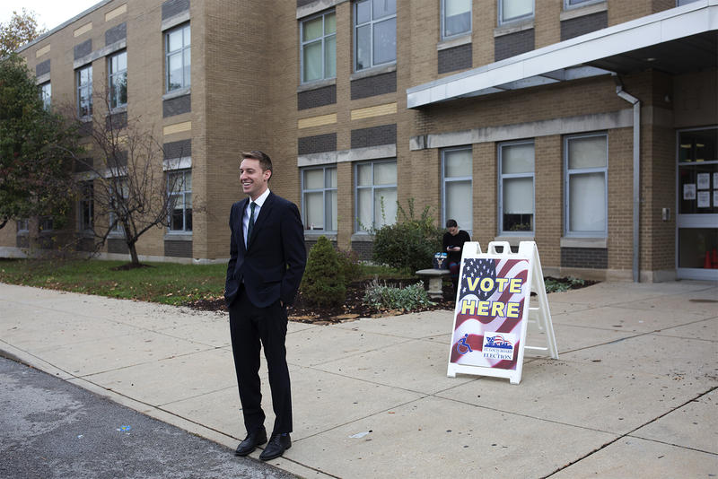 Former Secretary of State Jason Kander stands outside a St. Louis polling place on Election Day in 2016.