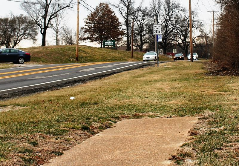 A sidewalk along Bellefontaine Road in Bellefontaine Neighbors doesn't quite make it to the Metro bus stop.