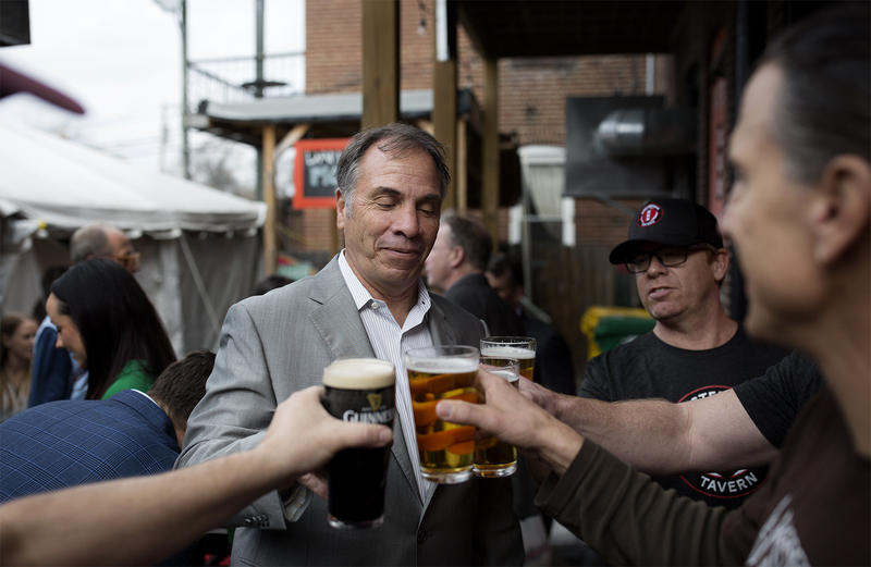 Bruce Arena, head coach of the U.S. Men's National soccer team, has a beer with the owners of the Amsterdam Tavern after speaking with reporters and fans.  (Feb. 28, 2017)
