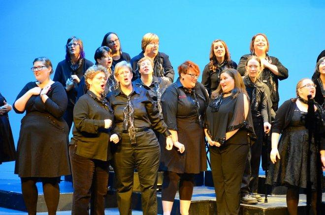 Members of the Charis women's chorus perform at a recent event, in this file photo.