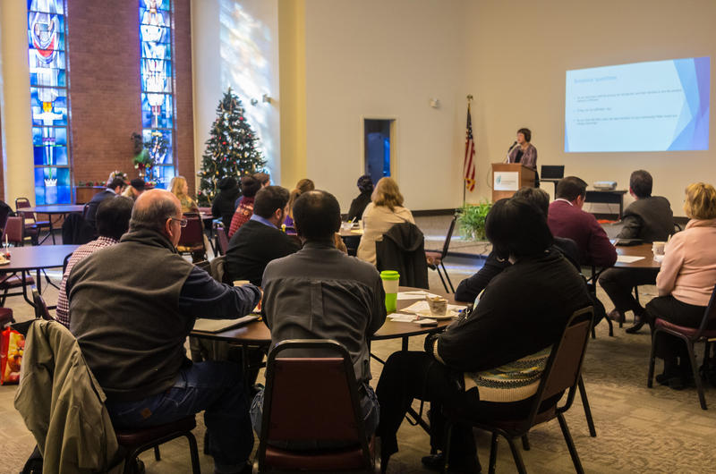 Stakeholders attend a New American Alliance community meeting to discuss ways to better serve and connect with new immigrants to St. Louis.
