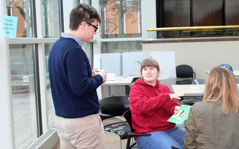 St. Louis area high school juniors Connor Ouchi (left) and Shawnee Boswell work on an exercise about making tough decisions during Youth Leadership St. Louis' Diversity Day on Sat., Feb. 18, 2017.