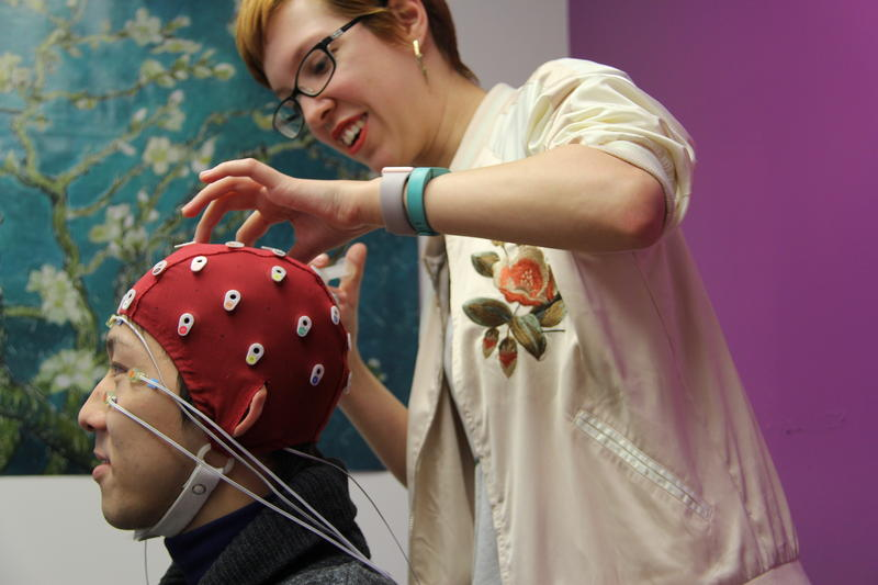 UMSL neuroscience major Katrina Lynn injects a gel into a brainwave-reading cap worn by subject Kohei Kikuchi in January 2017.