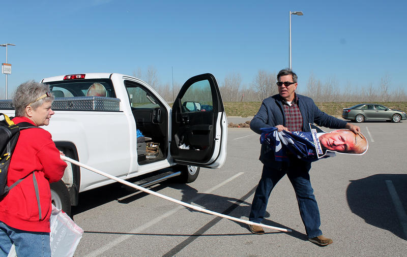 Kathie Stussie helps Ben Murphy attach a Trump flag to PVC pipe in the parking lot of an outlet mall in Chesterfield, where they met to caravan to the Trump rally in Jefferson City Saturday, March 4, 2017.
