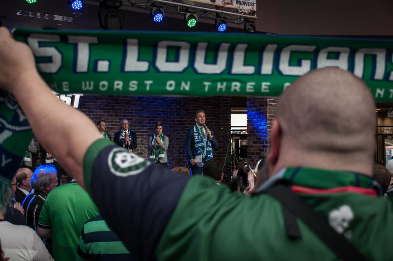 Fans watch Taylor Twellman, a St. Louis native and former U.S. men's national team player-turned-ESPN commentator, speak Monday, at a rally supporting a soccer stadium. March 27, 2017