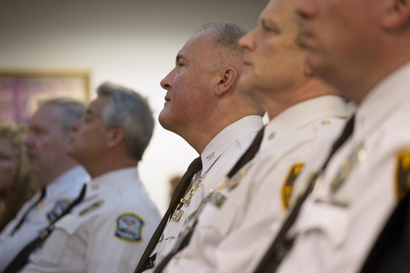 St. Louis County Police Chief Jon Belmar (center) listens to remarks by U.S. Attorney General Jeff Sessions. (03/31/17, Eagleton courthouse)