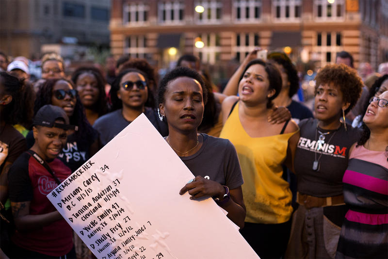 Tara Thompson, of Hands Up United, leads a vigil and march to honor and remember slain black women in downtown St. Louis on July 13, 2016.