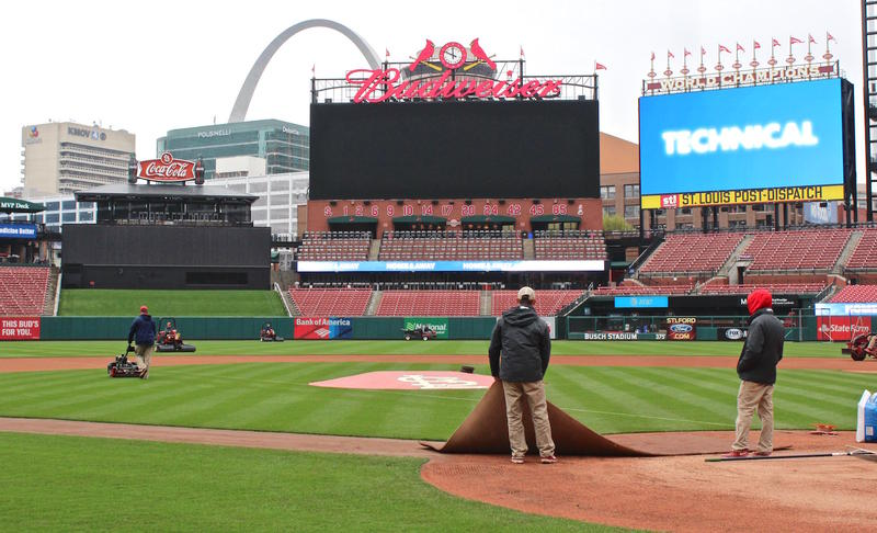 The grounds crew prepares the field at Busch Stadium for the Cardinals home opener on Sunday night. Photo was taken on March 29, 2017.