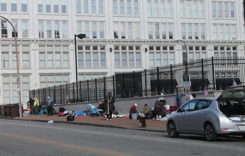 People camp out on the sidewalk outside New Life Evangelistic Center a day before the shelter at 1411 Locust St. is slated to close April 2, 2017.