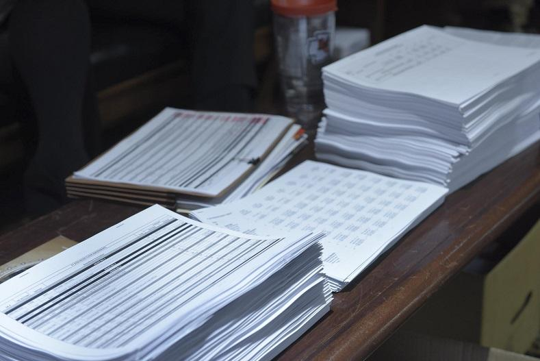 Copies of Missouri's next state budget sit on a Missouri House member's desk.
