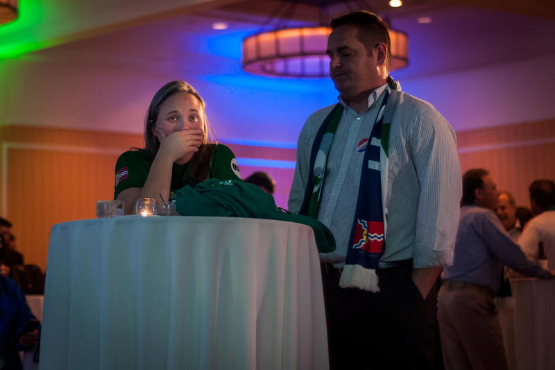 Lauren Rapp, from St. Louis, watches Proposition 2 election results with Bo Thomas. A bid to publicly fund a soccer stadium failed to pass on Tuesday.