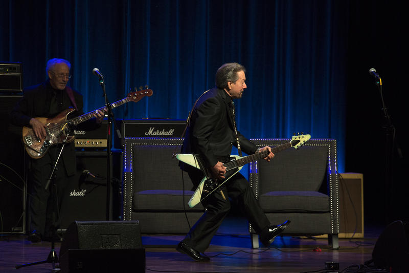 Musician Billy Peek shows off Chuck Berry's signature duckwalk while playing the legend's hit song