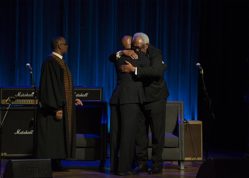 Charles Berry Jr.  receives a hug from his cousin Henry Berry III after speaking about his father, Chuck Berry. (April 9, 2017)