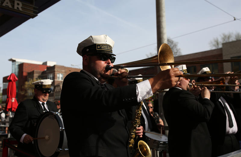 A band plays outside The Pageant at the start of a funeral procession for rock- 'n'roll legend Chuck Berry. (April 9, 2017)