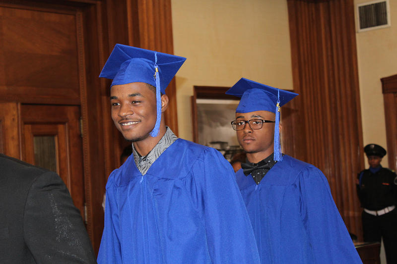 Cedric Deshay and Jeavon Gill walk into the mayor's office to receive their high school diplomas on April 13, 2017.