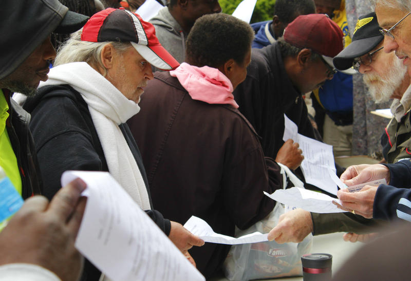 Ron Whelan signs the Rev. Larry Rice's petition addressed to the Governor to provide New Life with a building. 04/27/2017 in front of City Hall and Market Street