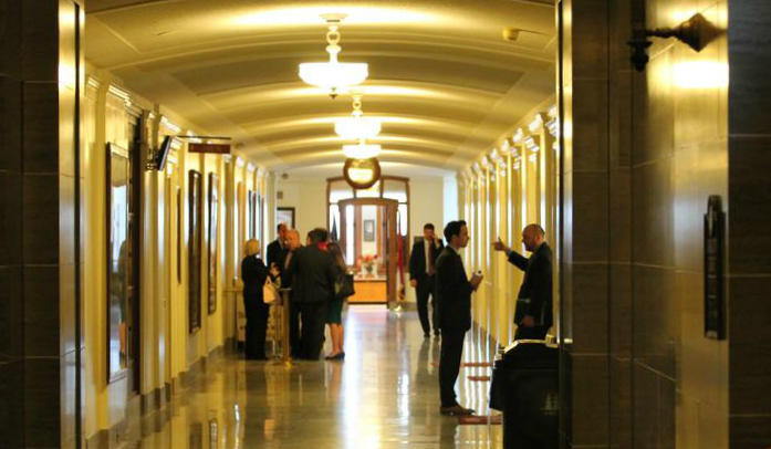 People mill in the hallway leading to the Missouri Senate chamber.