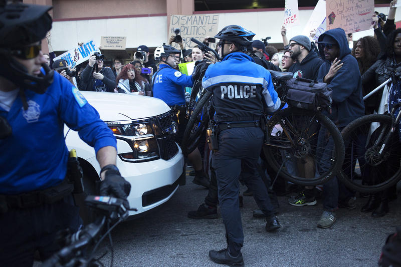 St. Louis Metro Police officers use bicycles to push back protesters at an anti-Trump rally in downtown St. Louis in November 2016.
