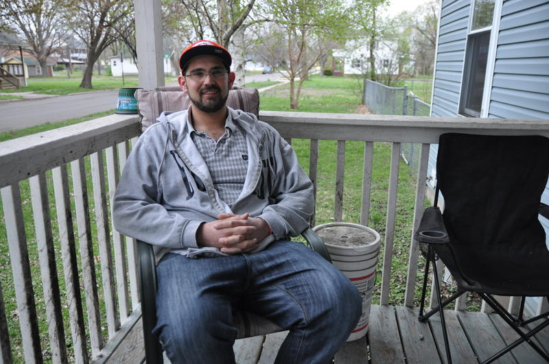 Sam Werkmeister, 30, sits on his porch in Granite City on March 30, 2017. Werkmeister is recovering from an addiction to opioids, which began with prescription pills.