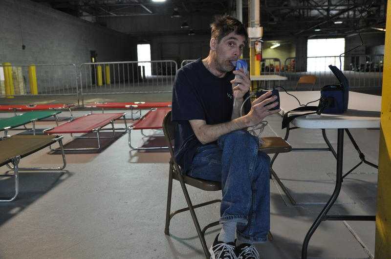 Richard Riegerix, 46, uses a breathing machine to treat emphysema in a temporary shelter set up in a city-owned warehouse. Riegerix stayed at New Life Evangelistic Center for three months before it was closed down by the city on April 2, 2017.