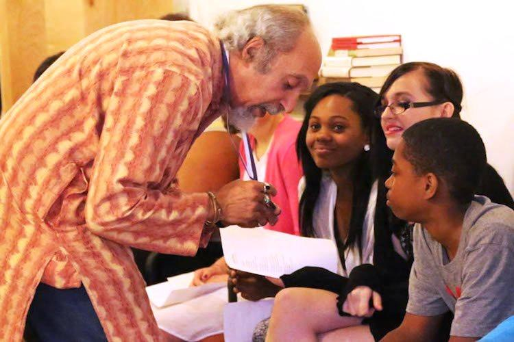 St. Louis Poet Laureate Michael Castro talks with students at an event presented by the 7th Grade Poetry Foundation.