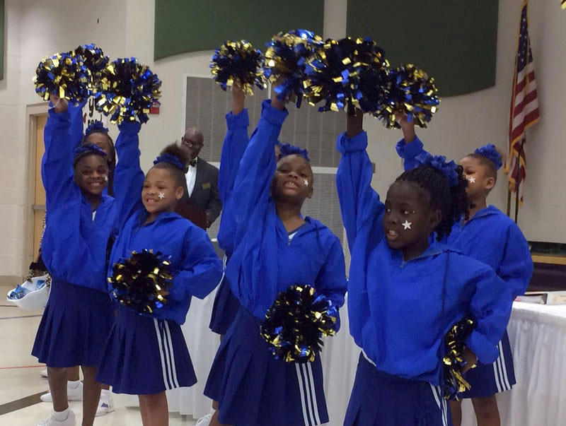 Students from Jefferson Elementary School cheer for the Normandy school board Thursday night, Jan. 28, 2016