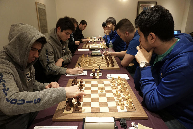 The Saint Louis University chess team engaged in chess matches with the Webster University team.