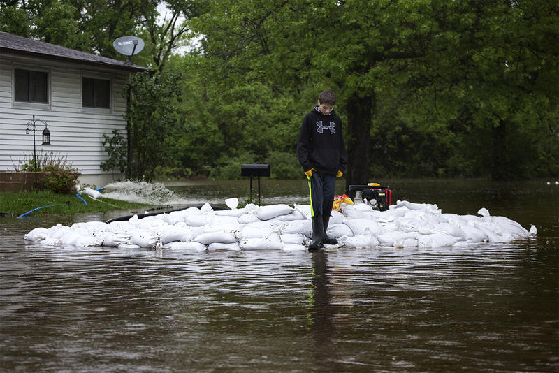 Ryan LaPlant, 13, helps pile sandbags near his grandparents' house in Arnold. May 2017
