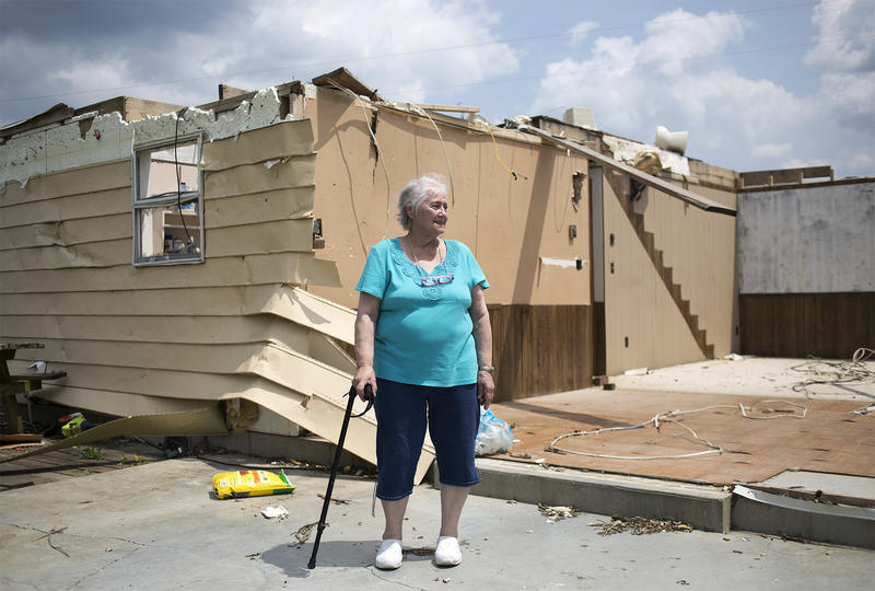 Sue Spencer surveys what remains of her home on County Road 806 in Perryville. A tornado tore through the area in late February, destroying the home she lived in for three decades.